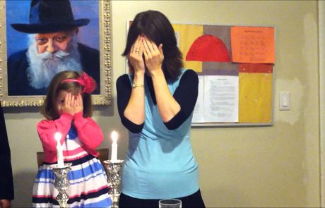 Young Girl Lights Her First Shabbat Candle